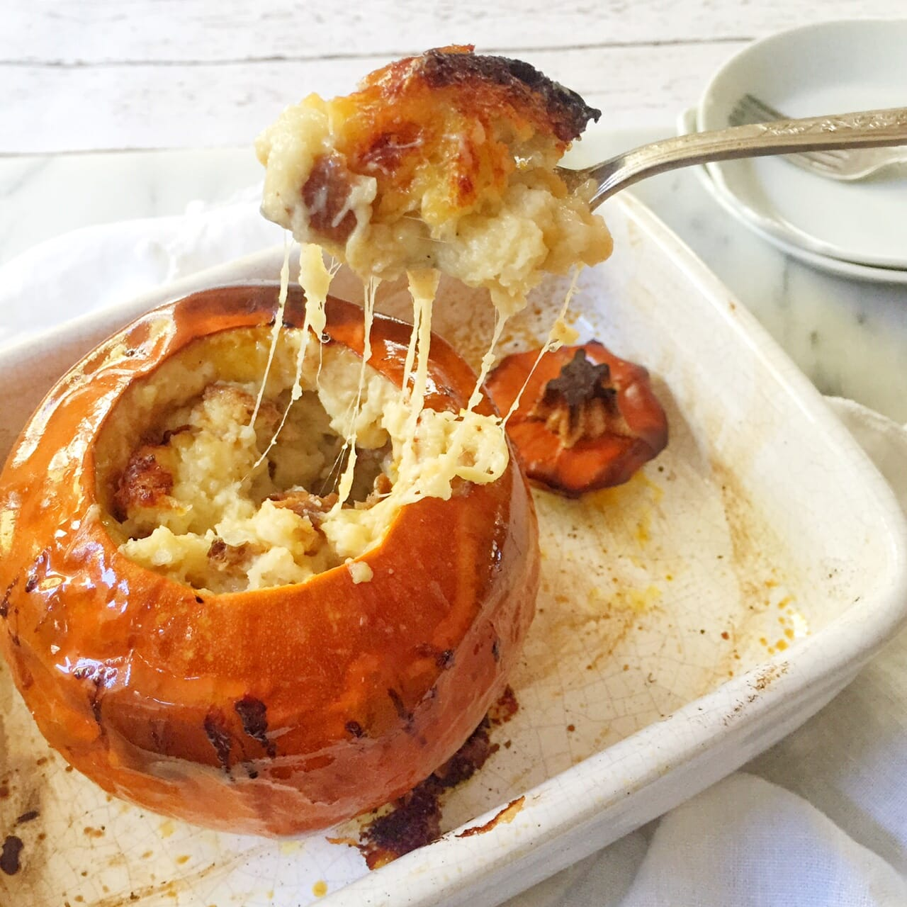 fondue in a roasted pumpkin