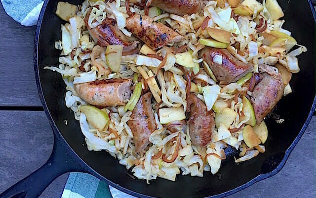 Sausage with cabbage and apples
